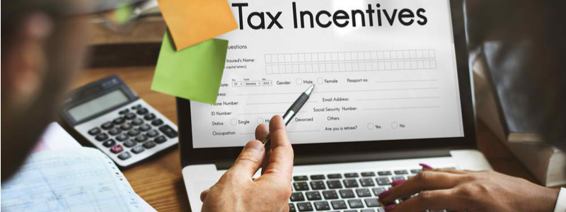 filling up tax incentive claim form on laptop